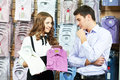 Man and assistant at apparel clothes shopping Royalty Free Stock Photo