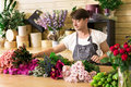 Man assistant in flower shop delivery make rose bouquet