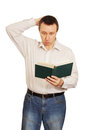 Man with astonishment looks in the book Stock Images