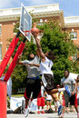 Man attacks basket against defender in outdoor basketball tournament athens ga usa august a young drives hard to the a a on held Royalty Free Stock Images