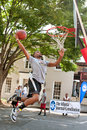 Man attempts slam dunk during outdoor street basketball tournament athens ga usa august a young jumps to the in an impromptu Stock Photos