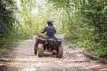 Man on the atv quad bike mountains road Royalty Free Stock Images