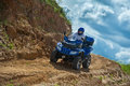 Man on atv a is riding the the sand Royalty Free Stock Photo