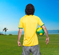 Man back with brasil jersey young of backs ball and green and yellow of the world looking the beach Royalty Free Stock Photography