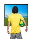Man back with brasil jersey young of backs ball and green and yellow of the world looking the beach for the window Royalty Free Stock Photos