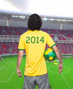 Man back with brasil jersey young of backs ball and green and yellow of the world looking the beach for the window Stock Photo