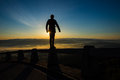 Man backlit at sunset on hill Stock Photo
