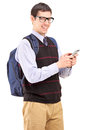 Man with backpack typing on his cell phone isolated white background Stock Photography