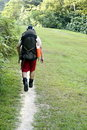 Man backpacking outdoors Royalty Free Stock Photo