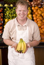 Man with banana Royalty Free Stock Photography