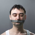 Man with bandage on face s portrait his which represents censorship of statements Royalty Free Stock Photography