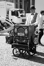 Man with barrel organ in city on sunny day Royalty Free Stock Photo