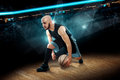 Man in basketball action game dribbles Royalty Free Stock Photo
