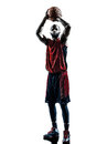 Man basketball player free throw silhouette one african in isolated white background Royalty Free Stock Images
