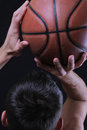 Man basketball player jumping dunking. Basketball player prepare to shoot ball.  Close up of man holding a basketball Royalty Free Stock Photo