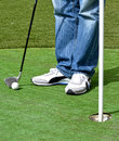 Man bat ball play minigolf Stock Image