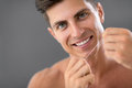 Man in bathroom dental hygiene young used floss Royalty Free Stock Photo