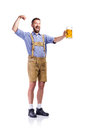 Man in bavarian clothes, holding beer, showing biceps Royalty Free Stock Photo