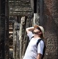 Man in bayon temple cambodia white Royalty Free Stock Images