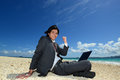 Man on the beach attractive young with a laptop Stock Photo