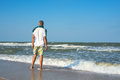 Man on the beach watching the waves Royalty Free Stock Photo