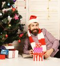 Man with beard holds present boxes pyramid Royalty Free Stock Photo