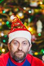 Man with beard in  New Year cap Royalty Free Stock Photo
