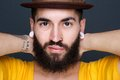 Man with beard and piercings close up portrait of a trendy young Royalty Free Stock Image