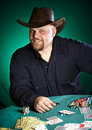 Man with a beard plays poker Royalty Free Stock Photo