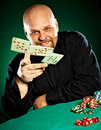 Man with a beard plays poker Royalty Free Stock Image