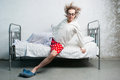 Man in the bed funny gets out of Royalty Free Stock Photography