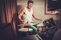 Man behind drums Royalty Free Stock Photo
