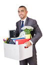 Man being fired with box of personal stuff Royalty Free Stock Image