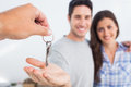 Man being given a house key with his wife Royalty Free Stock Images