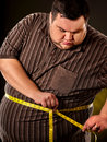 Man belly fat with tape measure weight loss around body. Royalty Free Stock Photo