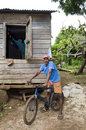 Man bicycle typical house rural nicaragua Stock Photo