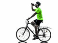 Man bicycling mountain bike drinking silhouette one exercising bicycle on white background Stock Photo