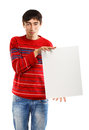 Man with big advertisement in red striped sweater stands on white background holding card Stock Photo
