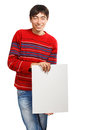 Man with big advertisement in red striped sweater stands on white background holding card Royalty Free Stock Photo