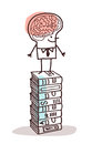 Man with big brain on stack of books Royalty Free Stock Photo