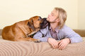 Man with big dog young at home playing a bullmastiff positively laugh Royalty Free Stock Images
