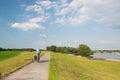 Man on bike near river Royalty Free Stock Photo