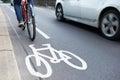 Man On Bike Using Cycle Lane As Traffic Speeds Past Royalty Free Stock Photo