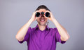 Man with binocular handsome on gray background Stock Images