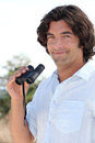 Man with binoculars spotting birds Royalty Free Stock Images