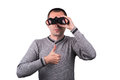 Man with binoculars young boy looking through and holding thumbs up on a white background Stock Photography