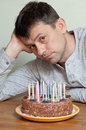 Man at birthday cake Royalty Free Stock Photos