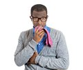 Man biting his tie closeup portrait of young nerdy unhappy funny guy with black glasses looking scared with craving for something Stock Images