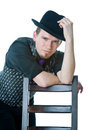 Man in black hat with chair Stock Photography