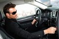 Man in black in luxury car Royalty Free Stock Photo